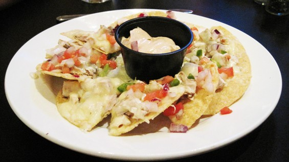 The nachos at Ozzie's Restaurant & Sports Bar - KRISTIE MCCLANAHAN