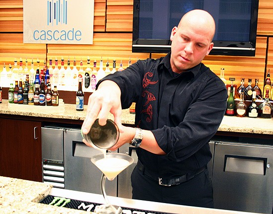 Devin Knau of Lumière Place Casino pours a high-roller cocktail. - KATIE MOULTON