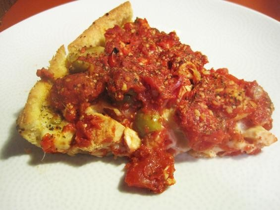"A slice of the ""Bucktown"" pizza from Pi - IAN FROEB"