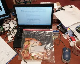 Eating leftover pizza at work because life is hard. - IMAGE VIA