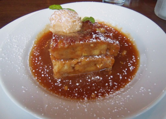 """Remy's Warm Apple and Golden Raisin Bread Pudding"" with brandy sauce. - EMILY WASSERMAN"
