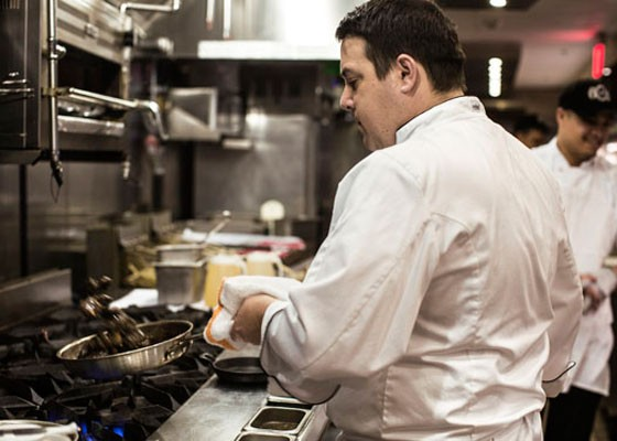 Executive Chef Christopher Dennis in the 801 Chophouse kitchen. | Jennifer Silverberg