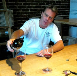 Bob Gray of Grapevine Wines pours a glass of garnacha. - ERIKA MILLER
