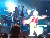 TLR shakin' it onstage with Santana earlier this year.