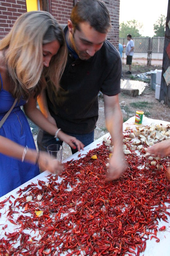Shannah Schoening and Michael Visintainer picking at the crawfish leftovers. - CASSIE KOHLER