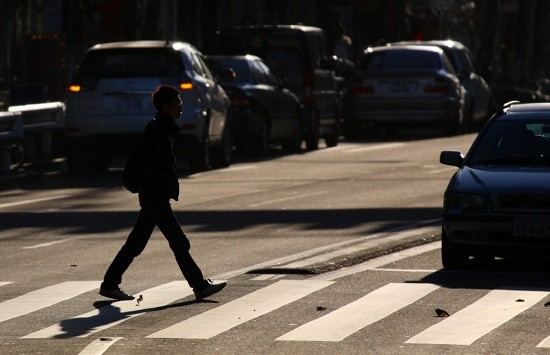 Crosswalk etiquette in the Loop dictates that this man will soon be flattened by that car, which will neither stop, slow down or even recognize what those lines in the road mean. - MRHAYATA