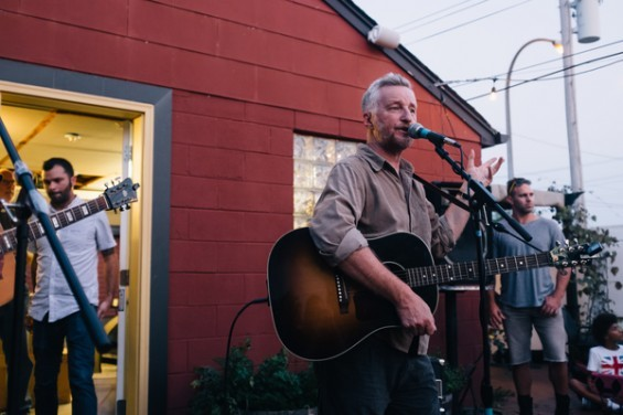 Billy Bragg addresses a crowd of about 100 people on the Royale's patio. See more photos here. - BRYAN SUTTER