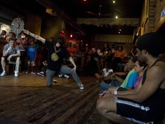 Breakdancing battles took place in the main room of Atomic Cowboy - JON GITCHOFF