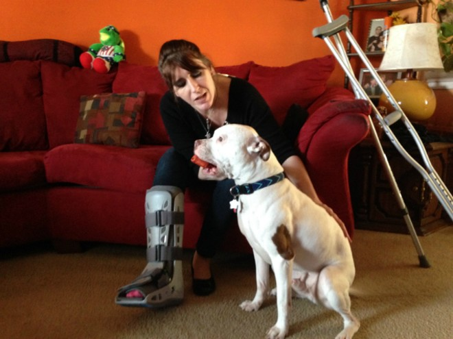 Peggy Cobb with King less than two months after a St. Louis cop shot her in the leg. - DOYLE  MURPHY