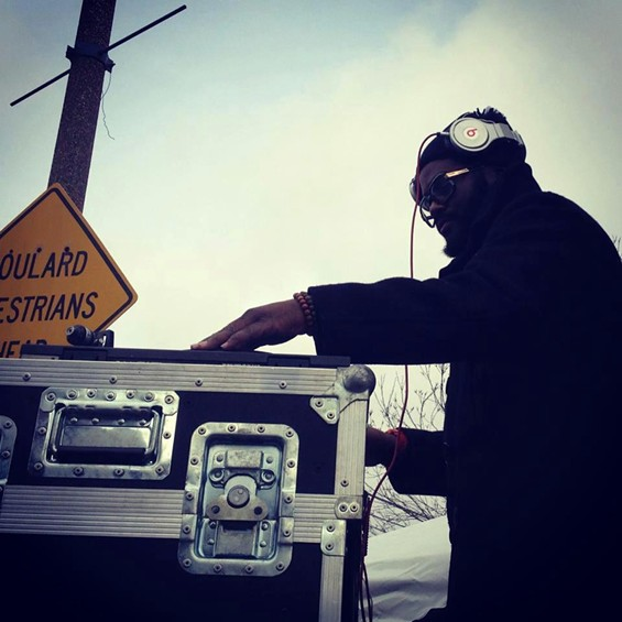 DJ Needles supplies the mix for the breakdancing battles; to see more photos, click on the pic. - JON GITCHOFF