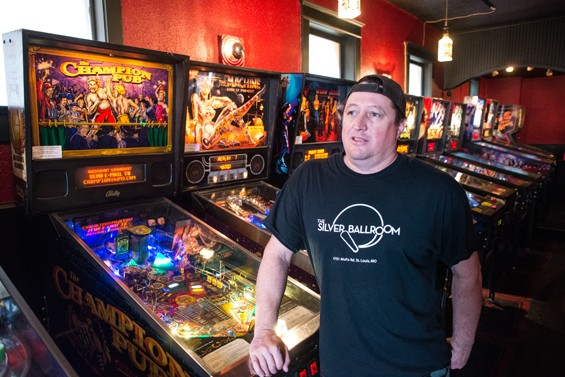 Doc, with some of the bar's pinball machines. - JARRED GASTREICH
