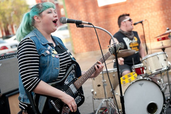 Bruiser Queen performing outside Apop Records. - JON GITCHOFF