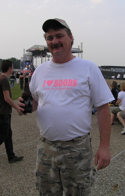 Granted it's a breast cancer awareness shirt, but he really does heart boobs.