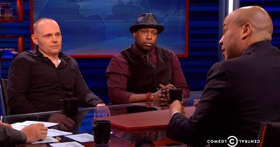 Comedian Bill Burr and rapper/activist Talib Kweli speak with host Larry Wilmore, Indian model/actress Shenaz Treasury and New Jersey-based U.S. Senator Cory Booker on The Nightly Show. - SCREENSHOT FROM THE VIDEO.