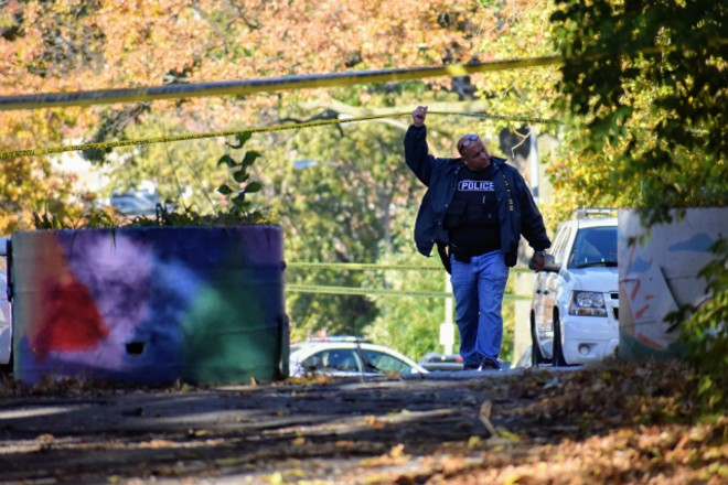 A St. Louis police officer walks onto the scene where a retired sergeant was killed this morning. - DOYLE MURPHY
