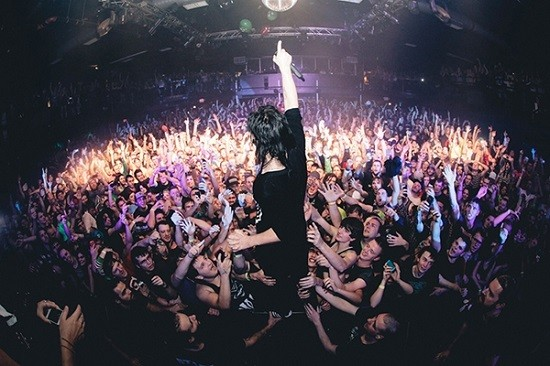 Skrillex's haircut from the back, performing live. - COURTESY OF BIZ3