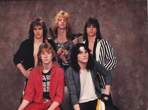 Obviously, the dude in the middle, wearing the sleeveless leopard print shirt, is too cool for this band. - SCOTT RUSSELL