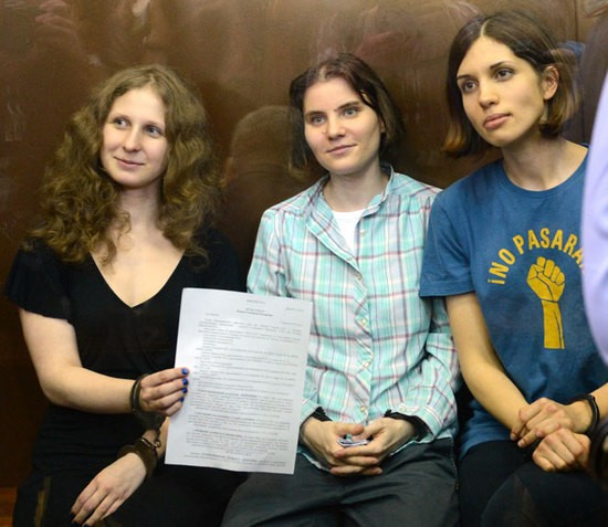 The members of Pussy Riot show the court's verdict, which led to their sentencing to two years in prison. - GETTY IMAGES