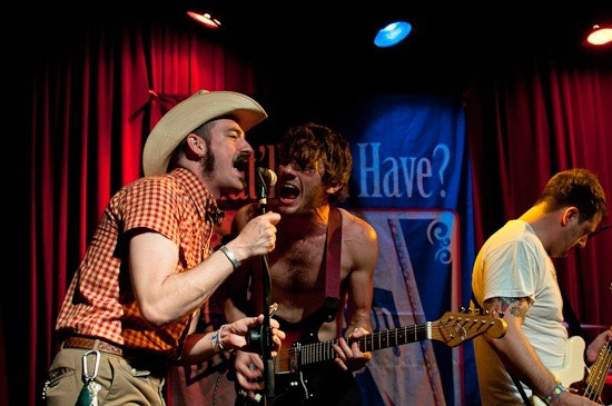 Band members Ryan Keonig and Chris Baricevic sing backup during the Bob Reuter's Alley Ghost set.