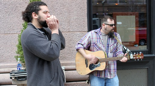 Brown Bottle Fever, a busking duo from South St. Louis, plays outside the Flamingo Bowl on Thursday. One St. Louis man wants busking to become a regular occurrence on Washington, and has plans to bring them downtown.