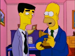 Homer Simpson proudly displays his Grammy Award for Outstanding Soul, Spoken Word or Barbershop Album.