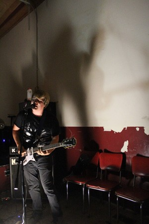 Guitarist and Vocalist Josh Jenkins blasts through a set at Illegal Tone on Belleville Main St. - MABEL SUEN