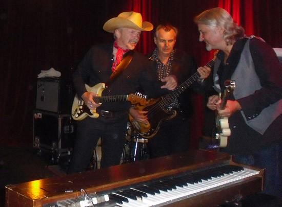 Dave Alvin and the Guilty Ones huddle at Off Broadway - ROY KASTEN