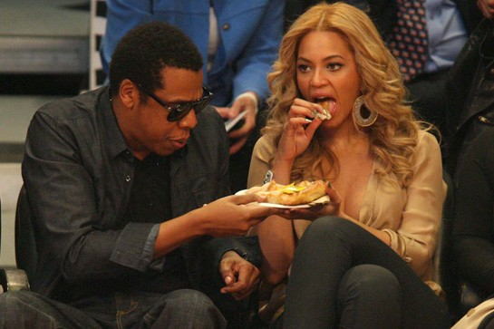 Jay-Z and Beyonce enjoy some junk food at a Lakers game.