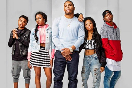 Nelly, with the cast of his upcoming show, a.k.a. his family. - PRESS PHOTO