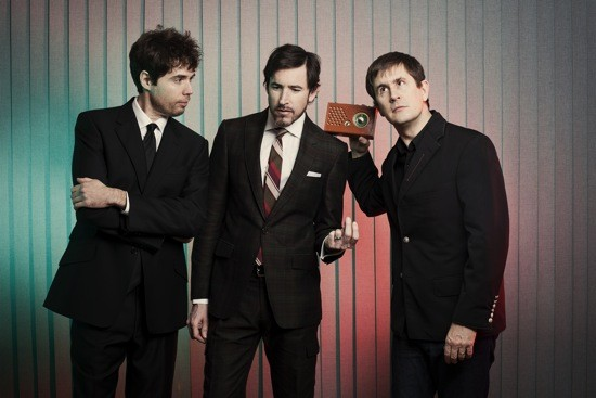 Peter Hughes (center, with his Mountain Goats bandmates) certainly doesn't. - D.L. ANDERSON