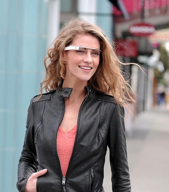 Google believes Google Glass users will look like this. She's smiling because someone just told her to join Google+