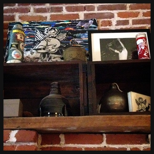 Reuter's ashes (in the bomb) lovingly displayed on Baricevic's mantle. - PHOTO BY JAIME LEES