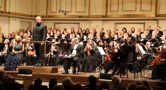Guest conductor Markus Stenz and members of the symphony as the demonstrators conclude their song. - SCREENSHOT FROM THE YOUTUBE VIDEO.