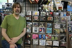 STEVE PICK WITH SOME OF TODAY'S RELEASES. PHOTO BY CHRISSY WILMES.
