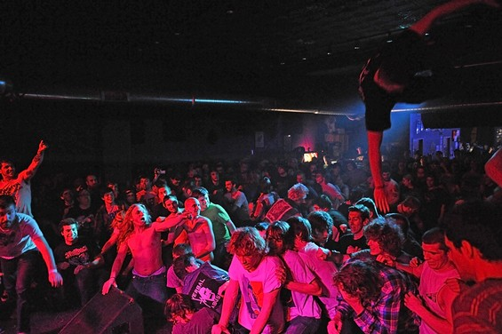 A fan jumps off the speaker monitor during Formaldehyde Junkies' set on Saturday night at Fubar.