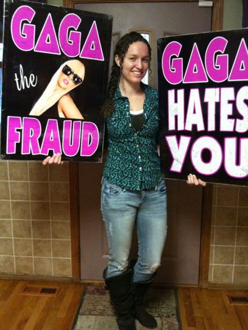 Megan Phelps, apparent heir to the hate-mongering throne of her grandfather, Pastor Fred Phelps, shows off these signs she planned on hoisting tonight in front of the Fox Theatre.