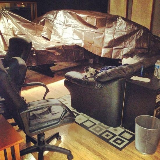 """Firebrand's consoles, covered in tarps. """"We're not taking any chances."""""""