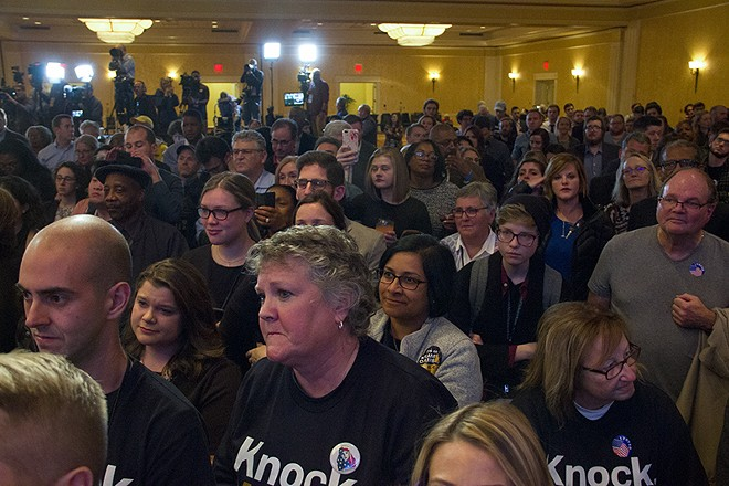 McCaskill supporters and volunteers listen to their candidate's concession speech. - DANNY WICENTOWSKI