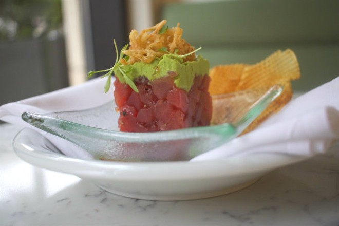 Tuna tartare is served with avocado and a soy lime dressing. - CHERYL BAEHR