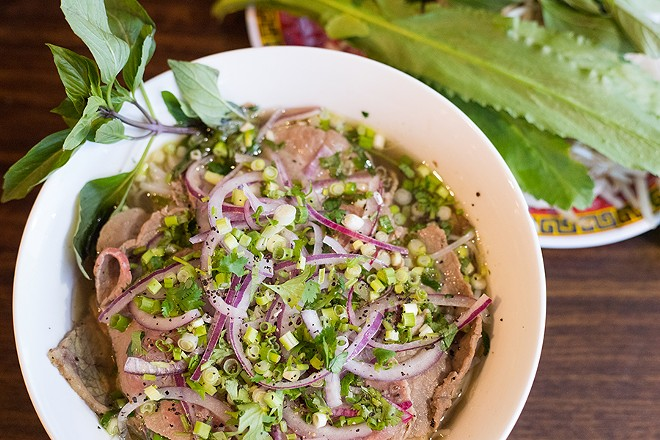 Pho dac biet combines rice noodles, beef meatballs, medium-rare sliced beef and brisket in a savory broth. - MABEL SUEN