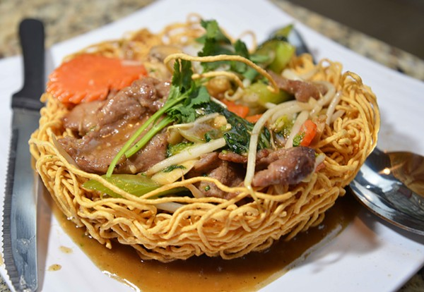 Pan fried egg or rice noodles are served with different forms of protein, such as beef pictured. - TOM HELLAUER