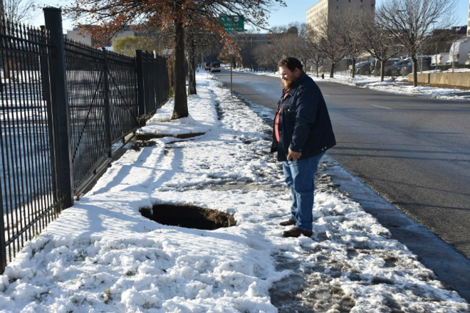 The sinkhole is already attracting visitors. - DOYLE MURPHY