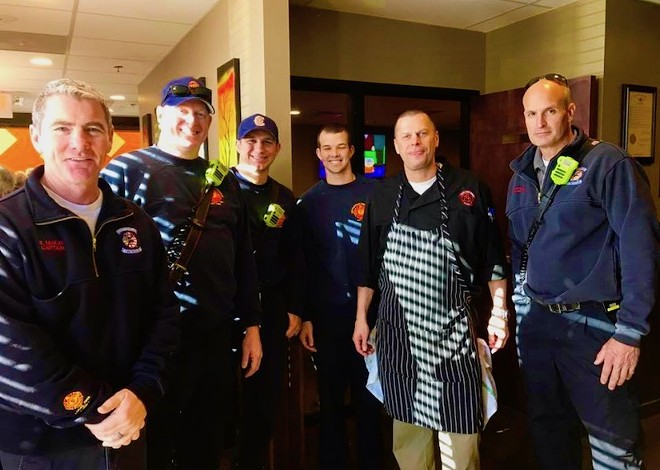 Scott Ellinger, second from right, with fellow Thanksgiving helpers. - COURTESY OF THE BRASS RAIL