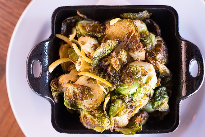 Each steak comes with your choice of side, including flash-fried Brussels sprouts. - MABEL SUEN
