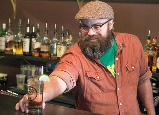 Managing partner Brandon Cavanagh behind the bar at the Demo.