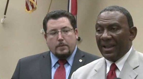 "Ed Beasley (right), Ferguson's new city manager, told a press conference that taking the position was ""a calling"" and ""a great opportunity."" - FOX2"