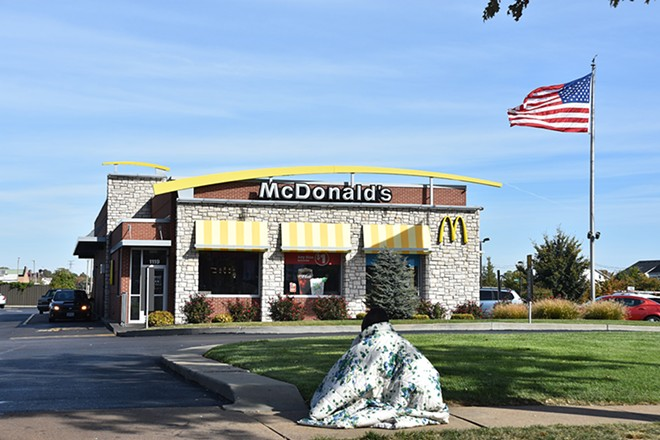The edge of the McDonald's drive-through is one of Jaz's primary panhandling spots. - DOYLE MURPHY