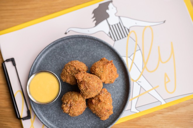Deviled crab fritters are delightful shellfish puffs, made even more so when dipped into the accompanying passion fruit mustard. - MABEL SUEN