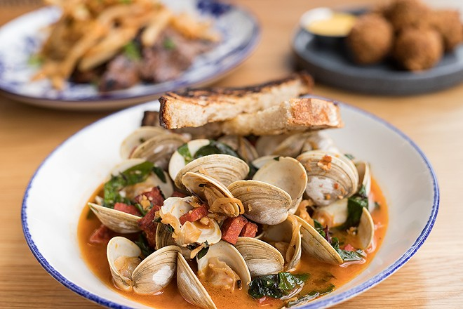 """""""Wu Tang Clams"""" are served with Portuguese sausage in a white wine broth. - MABEL SUEN"""