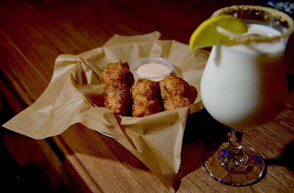 Conch fritters with key lime remoulade are available for $12.99. - TOM HELLAUER